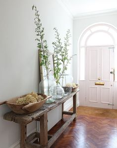 Heavenly Hallways. Love the color and light, plus the bench and different heights of decor.