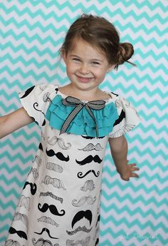 Mustache Dress is Must Have Dress - Girl. Inspired. Peasant style dress with rows of ruffles across the front