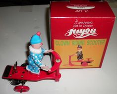 Juyou Clown Riding Scooter Vintage Tin Wind by thecollectiblechest