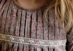 Lots of beautiful sewing details and trim work!