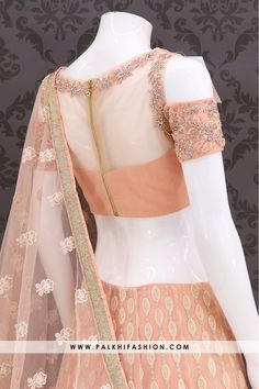 Palkhi fashion exclusive light peach colored designer lehenga choli set featuring self color lakhnavi work embroidery on pure chiffon fabric along with beautiful pattern all over the lehenga.Blouse done with appealing stone work with cold shoulder designs Netted Blouse Designs, Fancy Blouse Designs, Blouse Neck Designs, Lehenga Choli Designs, Light Peach Color, Net Blouses, Stylish Blouse Design, Designer Blouse Patterns, Indian Designer Outfits