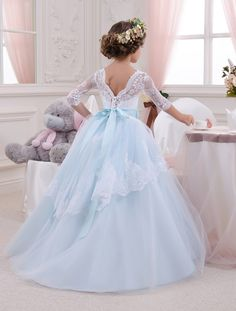 Gorgeous white and blue flower girl dress with multilayered skirt, lace corset with buttons, lacing and satin stripe with bow.  Item material: