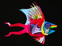 Recycled fish sculpture... I like that this is a sculpture.  This is a great way to teach kids about 3-d art in a non-expensive art.  It also teaches them that art can be made out of anything.