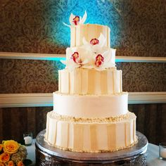 Four Tier Round Wedding Cake with Pink & White Orchids, & Fondant Stripes.
