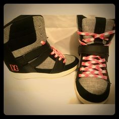"DC wedge kicks Show very little wear . Excellent . 5 woman or 3.5 youth girls . Have interior wedge . Approx.3 "" tall DC Shoes Sneakers"