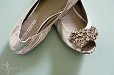 Vera Wang lavender flats...blinged out fancy flats as potential solution to avoid being taller than my honey in all of our wedding photos. currently can't find these for sale anywhere, but older searches suggest they were originally in the $260+ range, but I refuse to pay that much.