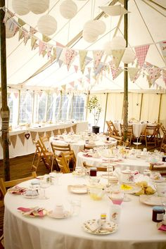 Bunting inside a tent or outside is cost effect decor. Love this china to set off  English tea party theme.