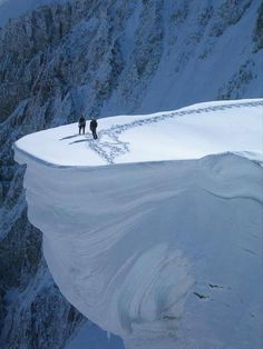Impressive Photo Of 2 Climbers Standing On A Snow Cliff In Siberia