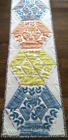 Bella table runner. Learn how to make it at http://debbykratovilquilts.blogspot.com/