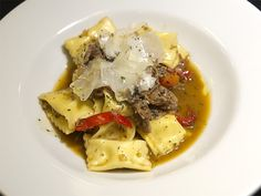 Agnolotti filled with tart goat cheese and mixed with braised lamb at the Wooden Table.