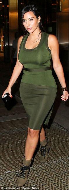 Kim Kardashian wearing Giuseppe Zanotti for Balmain lace-up studded booties & a Givenchy dress.