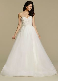Ivory tulle natural waist bridal ball gown, strapless sweetheart bodice with layered lace detail, full tulle box pleated skirt with horsehair hem and chapel train. Available Spring 2016