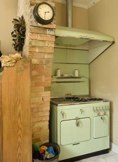 Vintage green stove & exposed brick--in the same space