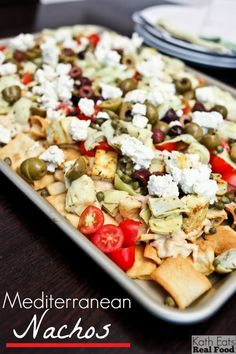 Mediterranean nachos are a perfect party platter for you Super Bowl party.