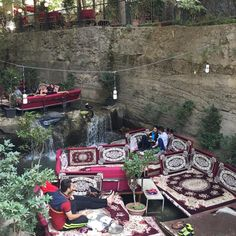 Darband, high in the mountains north of Tajrish in Northern Tehran, is a popular attraction for visitors on weekends. During the hot summer months, its trees and river cool this area significantly, making it the perfect place for couples and friends, like these, to enjoy breakfast. A typical Iranian breakfast includes bread, usually Barbari (a sourdough) fresh feta cheese or butter, jam, eggs and of course, tea. Simple but delicious. #storiesofiran #iran #tehran #everydayiran #everydaytehran