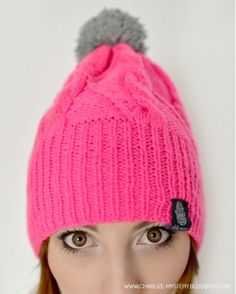 Neon cabled beanie with fluffy pompom