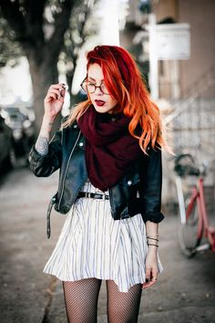 Le Happy wearing Joa striped skater dress and burgundy scarf with a biker jacket