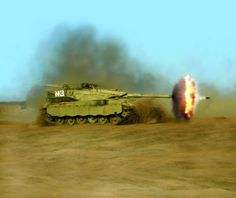 An Israeli Merkava firing note the round just visible leaving the barrel