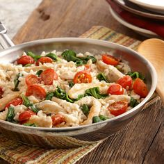 Add cherry tomatoes and spinach to creamy chicken and rice for a one-skillet dinner with fresh colorful vegetables.