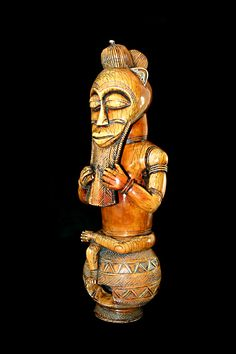 Africa | Seated Figure from the Baule people of the Ivory Coast | Ivory | 20th century