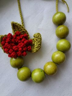 crocheted rose and wooden beads