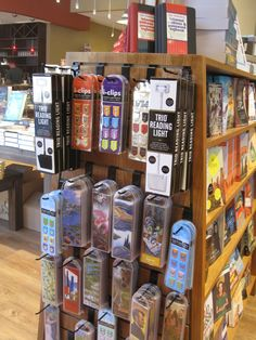 Why carry an ugly wire rack for bookmarks when you can display them on a slatwall endpanel near the cash wrap? Just add hooks. Cash Wrap, Stationery Store, Slat Wall, Circus Party, Bookstores, Java, Book Lovers, Bookmarks, Spectrum