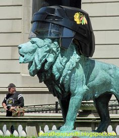 (Photo) Art Institute lion with Chicago Blackhawks helmet - http://marathonpundit.blogspot.com/2015/06/photo-art-institute-lion-with-chicago.html
