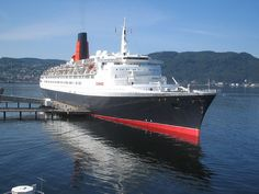 R.M.S. Queen Elizabeth 2. (QE2) Ocean liner built for Cunard in 1969.Retired & acquired in 2008 by Istithmar Investments Dubai.Designed for service from home port of Southampton to New York & named after earlier Cunard liner RMS Queen Elizabeth. Served as flagship of the line from 1969 until succeeded by RMS Queen Mary 2 in 2004. Designed in Cunard's then headquarters & regional offices in Liverpool & Southampton & built in Clydebank,Scotland. My grandmother's preferred way to come to visit…