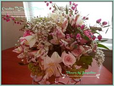 Pastel Spring bouquet containing Pink and White Roses, Boronia, Baby's Breath, Alstroemeria (Peruvian Lily),  and tiny Green Hydrangea.