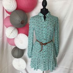 To TOTALLY Die For!! One of our hottest sellers. The cutest ruffle hem dress with dainty flowers. This season is all about flowers…Button up and long sleeve with pockets! Comes with belt. Higher in th