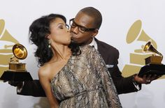 """Singer Kirk Franklin kisses his wife Tammy as he holds his awards for """"Best Gospel Album"""" and Best Gospel Song (Hello Fear) at the 54th annual Grammy Awards in Los Angeles, California, February 12, 2012. (Reuters/)"""