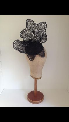 "Sculpted black lace headpiece on 4"" cocktail button base by Murley & Co Millinery.  $245 inc hatbox.  www.facebook.com/murleyandcomillinery  www.murleyandco.com"