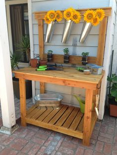 DIY Potting Bench made from 2x4s and repurposed wood pallet with mason jar herbs attached.