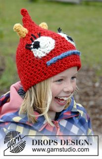 """Crochet DROPS monster hat with horns, eyes and mouth in """"Eskimo"""". ~ DROPS Design"""