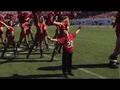 YES! Get it lil man!-Tampa Bay Buccaneers Cheerleaders with Capt. Fear & Christian aka Little Fear.