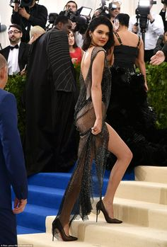 Belle of the ball: Kendall couldn't help but turn heads as she climbed the stairs at the f...