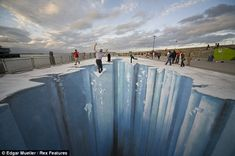 Edgar Mueller - The Crevasse: The giant fissure, in Dun Laoghaire, Ireland, spans over 250 square metres and appears to show an Ice Age fault. The image only makes sense from one point of perspective. 3D Street Art.
