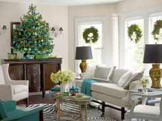 A festive room Christmas tree with basic glass ornaments in blue, green, and gold.