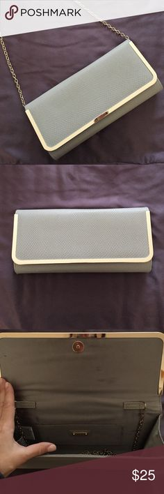 Grey with gold details purse/clutch Adorable grey and gold purse/ clutch. Chain Strap is removable. Purchased from Aldo. Nice condition- small stains only on inside (3rd pic) Aldo Bags Crossbody Bags