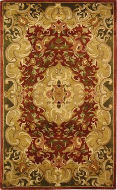 <BR><li>Add a touch of classic style to your home decor with this traditional rug<li>This hand-tufted Juliette rug features a rust background and a green border <li>100-percent wool pile provides comfort and softness to the touch
