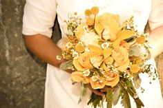 Pretty splash of gold mixed in with some deep rust or burnt orange with cream or ivory flowers and roses and greenery. I love this!