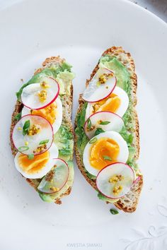 avocado, egg, radish, and french mustard on ezekiel toast