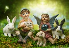 Mini fairies and rabbits in the spring fairy garden.