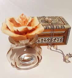 Small Vintage Glass Perfume Bottle With Rose Shaped Stopper And 925 Silver Label.