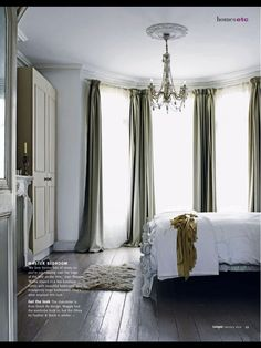 A great idea for a bay window and the puddling drape on the floor really compliments the style of the room!