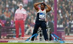 Great Britain's Derek Derenalagi competes in the men's discuss throw F57/58 final.