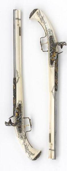 Pair of ivory-stocked flintlock pistols 1645 - 1650, w ith later stocks: