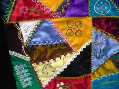 Beautiful crazy quilt.  Reminds me of one my mother had when we were growing up.  I wonder what happened to it?