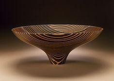 A bowl that goes with that wood tile flooring. I believe this is on display at the LACMA. The artist glues thin layers of different wood into a block and then lathes it into the shape of a bowl. Wow!