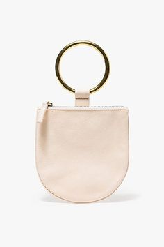 If you only carry keys and some spare change, take advantage of your light load with an Insta-worthy pouch.Otaat/Myers Collective Ring Pouch, $120, available at Need Supply Co. #refinery29 http://www.refinery29.com/stylish-travel-bags#slide-1